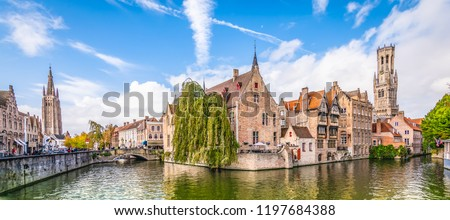 Panoramic city view with Belfry tower and famous canal in Bruges, Belgium. Сток-фото ©