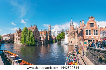 Panoramic city view with Belfry tower and famous canal in the historical part of Bruges, Belgium. Travel to Belgium. #1442520314