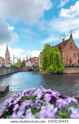 Panoramic city view with Belfry tower and famous canal in the historical part of Bruges, Belgium. Travel to Belgium. #1459230491