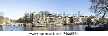 Panoramic city view with the Thiny bridge in Amsterdam the Netherlands