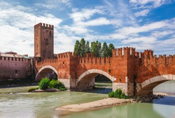 Panoramic cityscape aerial view on Verona historical center, bridge and Adige river. Famous travel destination in Italy. Old town where lived Romeo and Juliet from Shakespeare story