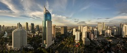 Panoramic cityscape of Indonesia capital city Jakarta at sunset. A rare clear day in the polluted city.