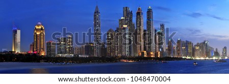 panoramic cityscape skyline view to the Dubai Marina Bay with skyscrapers during sunset