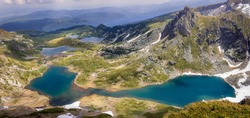 Panoramic, colorful, sunlit view from the Lakes summit on Rila mountain of The Twin lake, The Trefoil lake, Fish Lake and The Lower lake