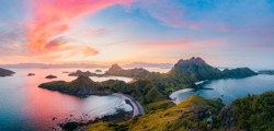 Panoramic colorful sunset view of Padar Island in an evening from Komodo Island (Komodo National Park), Labuan Bajo, Flores, Indonesia