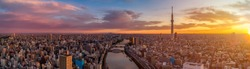 Panoramic Dawn view of Tokyo city. Famous Tokyo Skytree and Senso-Ji Temple with Sumida river. Colorful morning scene of Japan, Asia. Traveling concept background.