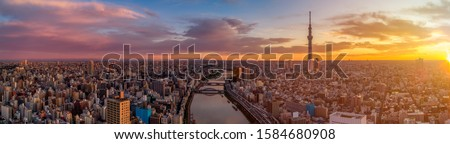 Photo of  Panoramic Dawn view of Tokyo city. Famous Tokyo Skytree and Senso-Ji Temple with Sumida river. Colorful morning scene of Japan, Asia. Traveling concept background.
