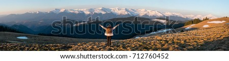Panoramic. Full length rearview shot of an adventurous female hiker standing on top of the mountain with her arms spread lifestyle vitality happiness achievement hiking travelling nature