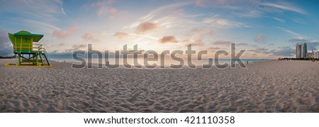Panoramic image 180 degrees of world famous travel location, Miami beach, Florida. Lifeguard tower in a typical colorful Art Deco style and Atlantic Ocean at sunshine.