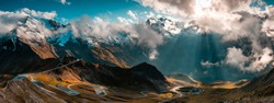 Panoramic Image of Grossglockner Alpine Road. Curvy Winding Road in Alps. Dramatic Sky.