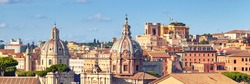 Panoramic image of Rome skyline. Beautiful view of Roman Forum and church cupola in Rome, Italy