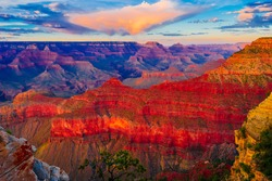 Panoramic image of the colorful Sunset on the Grand Canyon in Grand Canyon National Park from the south rim part,Arizona,USA, on a sunny cloudy day with blue sky