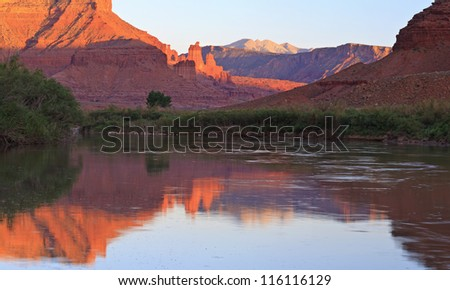Panoramic image of the Fisher Towers partially lit by the late afternoon sun reflected in the Colorado River near Moab,Utah