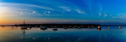 Panoramic image of the harbor at St. Andrews, New Brunswick Canada.  Sunrise shot of boats waiting for the day.