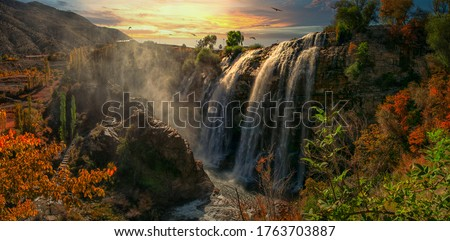 Panoramic image of Tortum (Uzundere) waterfall from down in Uzundere. Landscape view of Tortum Waterfall in Tortum,Erzurum,Turkey. Explore the world's beauty and wildlife.