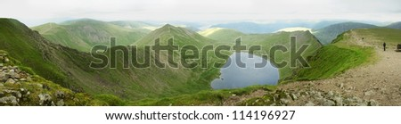 Panoramic landscape from the summit of Helvellyn, England's 2nd highest mountain, including Red Tarn and Striding Edge