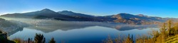 Panoramic landscape. Lake Orestiada or Lake of Kastoria; enclosed by mountains of excellent geomorphology, constitutes a unique hydrobiotope. Macedonia. Northwestern Greece.
