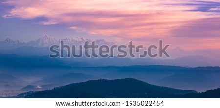 Panoramic landscape of great Himalayas mountain range during an autumn morning from Kausani also known as 'Switzerland of India' a hill station in Bageshwar district, Uttarakhand, India.