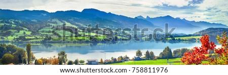 Panoramic landscape of lake Gruyere in Switzerland. Canton Fribourg, Switzerland      #758811976