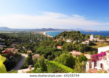 Panoramic landscape of recreational property, holiday second home in Spain, Europe - scenic view on residential houses, Mediterranean sea and mountains.