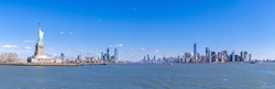 Panoramic landscape of Statue of Liberty with Manhattan downtown Skylines skyscraper building in background, NYC, New York State USA. New York Landmark Travel Destination and cityscape concept.