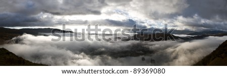 Panoramic landscape of the morning mist viewed from the fairfiled horseshoe, lake district,cumbria,england