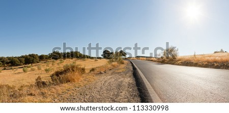 Panoramic landscape photo of road through Sierra de Grazalema national park. Beautiful scenery. Blue sky. Malaga. Andalusia. Spain.