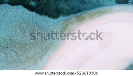 Panoramic landscape seascape aerial view over a Maldives Male Atoll island and empty white sandy shore coastline beach