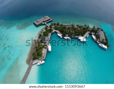 Stock Photo Panoramic landscape seascape aerial view over a Maldives Male Atoll islands.