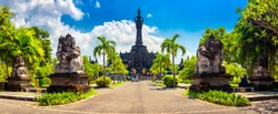 Panoramic landscape traditional balinese hindu temple Bajra Sandhi monument in Denpasar, Bali, Indonesia on background tropical nature and blue summer sky, Indoneisia