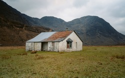 Panoramic landscape view Cuillin Mountains as its spectacular backdrop, the isolated fishing lodge at Camasunary Bay on the Isle of Skye is an unexpected treasure. Scottish Highlands, Scotland.