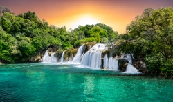 Panoramic landscape with beautiful waterfalls during the sunset in KRKA National park, Croatia.