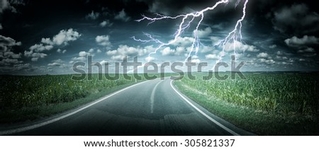 Panoramic landscape with thunderstorm over country road. Nature background