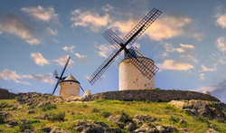 Panoramic landscape with two mills at sunset in the town of Consuegra in Toledo, Spain. Don Quixote Route.