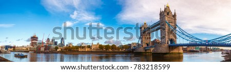 Panoramic London skyline with iconic symbol, the Tower Bridge and Her Majesty's Royal Palace and Fortress, known as the Tower of London as viewed from South Bank of the River Thames in the morning #783218599