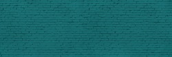 Panoramic Long And Wide Wall of Blue or Teal Bricks. Teal Wide Banner for Web With Textured Blue Surface. Luxury Facade or Face Wall in Trend Color.