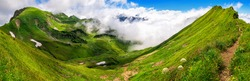 Panoramic majestic view on grasslands on the Bavarian Alps with blue sky and white clouds