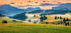 Panoramic morning scene of Compaccio village, Seiser Alm or Alpe di Siusi location, Bolzano province, South Tyrol, Italy, Europe. Fabulous summer sunrise of Dolomiti Alps.