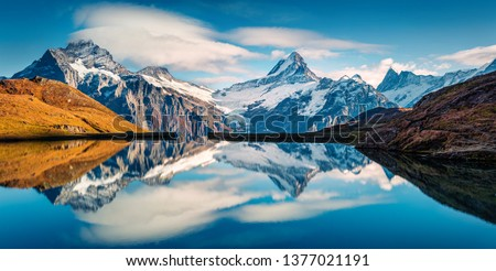 Panoramic morning view of Bachalp lake / Bachalpsee, Switzerland. Majestic autumn scene of Swiss alps, Grindelwald, Bernese Oberland, Europe. Beauty of nature concept background. #1377021191