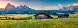 Panoramic morning view of Compaccio village, Seiser Alm or Alpe di Siusi location, Bolzano province, South Tyrol, Italy, Europe. Beautiful summer sunrise of Dolomiti Alps. Traveling concept background