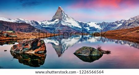 Panoramic morning view of Stellisee lake with Matterhorn / Cervino peak on background. Impressive autumn scene of Swiss Alps, Zermatt resort location, Switzerland, Europe.