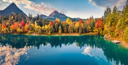 Panoramic morning view of Urisee lake. Astonishing autumn scene Austrian Alps. Calm outdoor scene of Austria, Europe. Beauty of nature concept background.