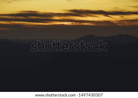 Panoramic mountain and dramatic sky sundown background in golden #1497430307