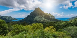Panoramic mountain peak landscape with Cook's Bay and Opunohu Bay on the tropical Island of Moorea, French Polynesia.