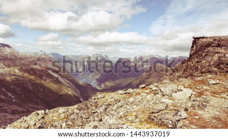 Panoramic mountains landscape with Geirangerfjord from Dalsnibba area. Geiranger Skywalk viewing platform on mountain in distance. Norway. #1443937019