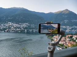 Panoramic Movie footage with gimbal and smartphone of the village of Torno in summer sunset, Lake Como, Lombardy, Italian Lakes, Italy, Europe