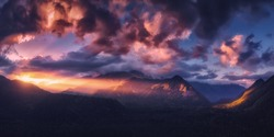 Panoramic nature mountains landscape. Dramatic sky at sunset. Aerial drone view from above