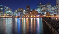 Panoramic night view of San Francisco skyline from Pier 14.