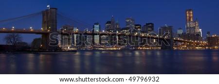 Panoramic of Brooklyn bridge at dawn
