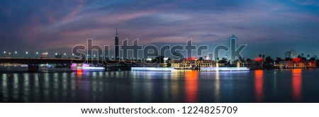 Panoramic of Cairo city center at night, long exposure with light trails of moving boats on the Nile river. #1224825709